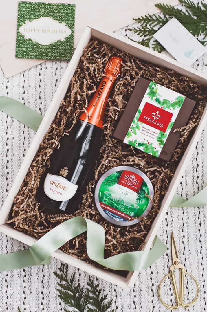 gift ideas, wooden box with champagne and scents and chocolates