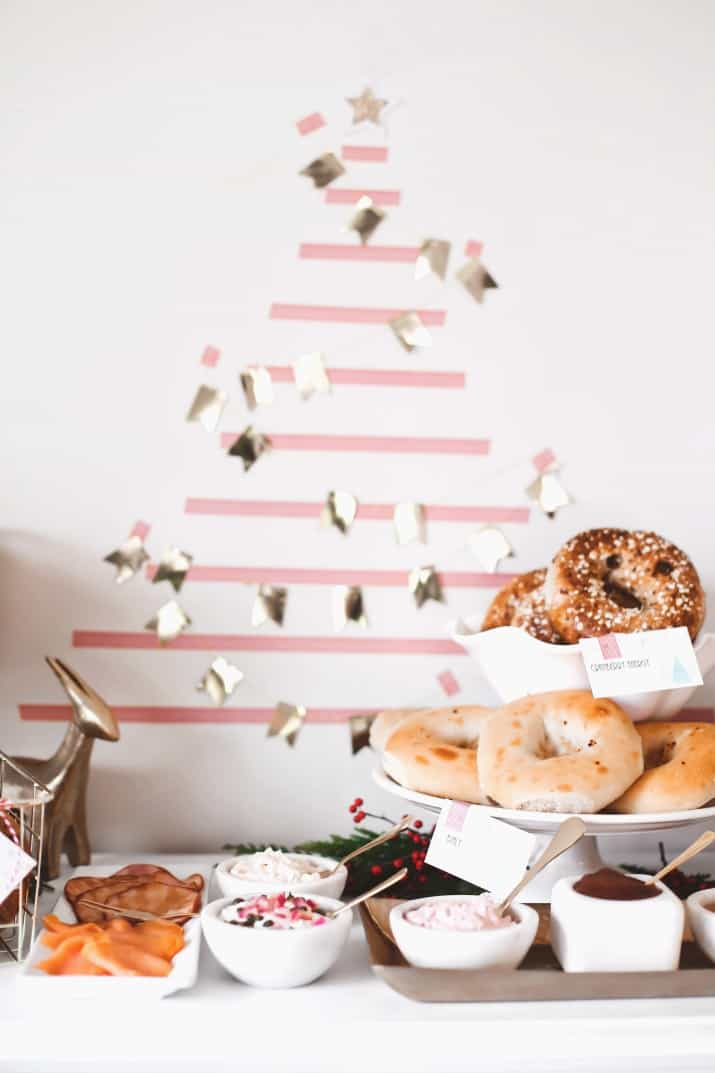 holiday bagel breakfast bar with Christmas tree wall decor