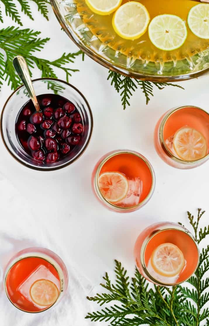 Salted Honey Whiskey Sour Punch with Drunken Cherries, overhead view
