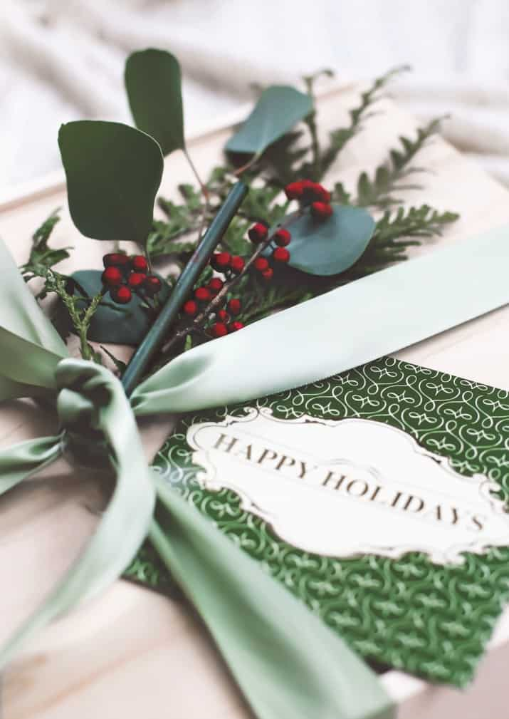 gift idea, scent stick tied on to ribbon on gift box