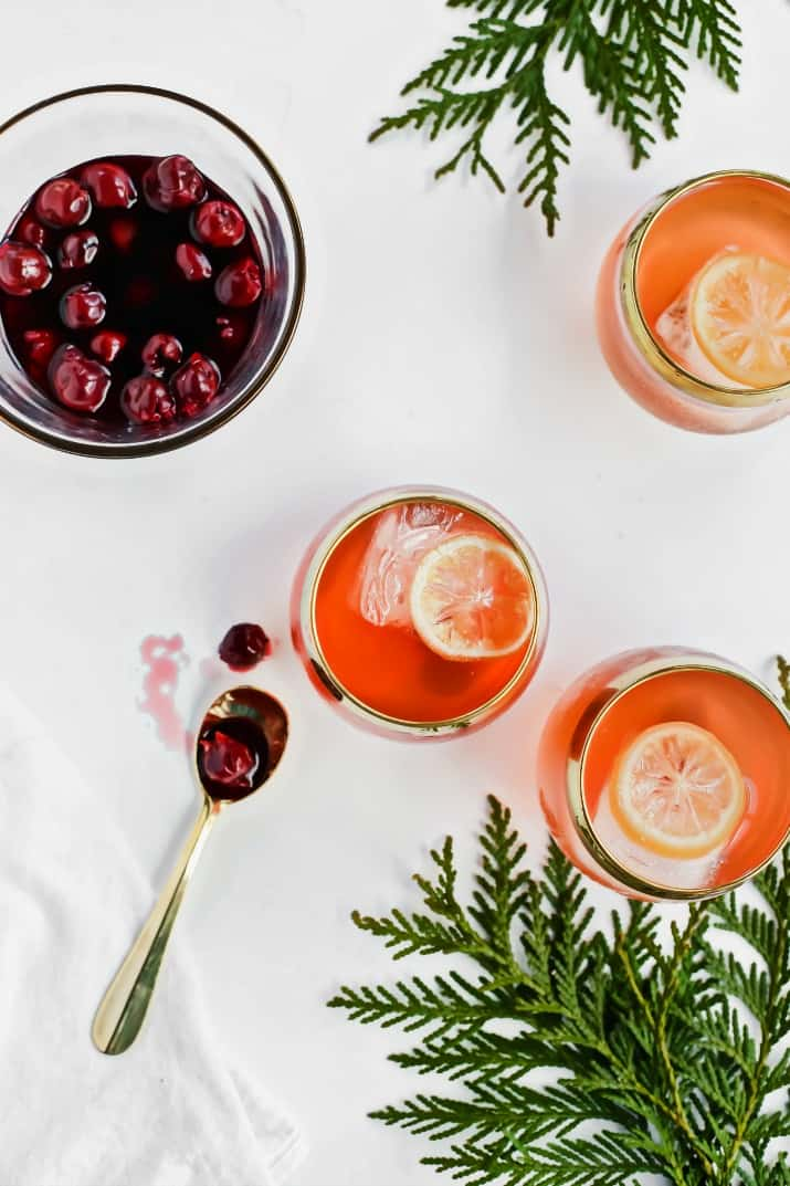 Salted Honey Whiskey Sour Punch with Drunken Cherries added