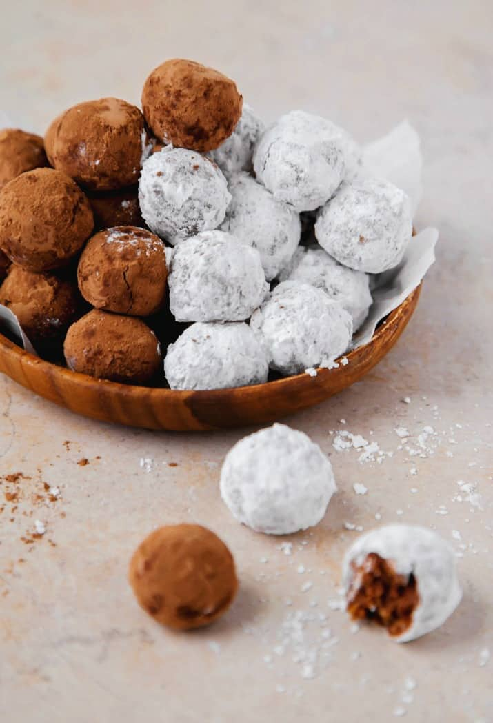 bourbon balls recipe, on wooden plate