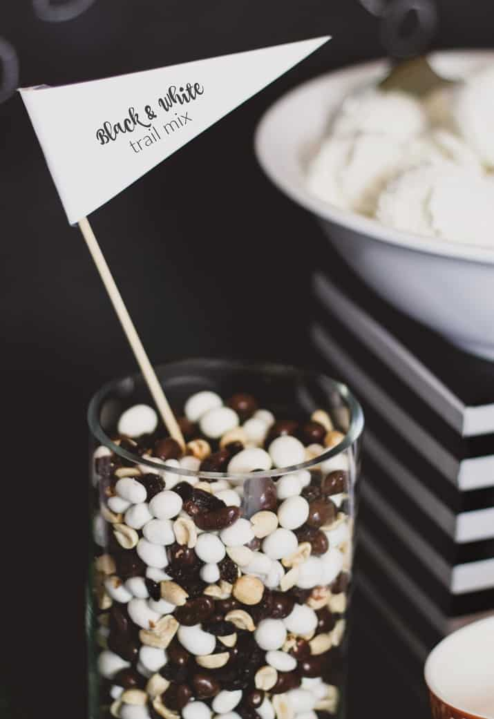 game day ice cream bar with black and white trail mix topping in glass jar
