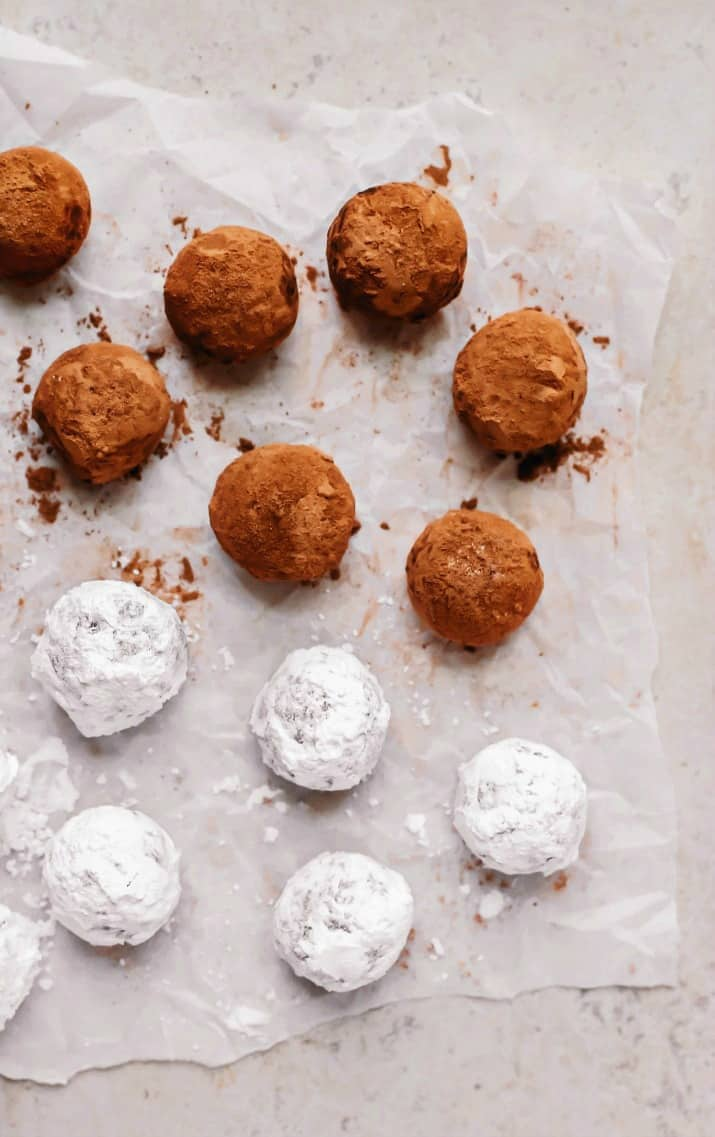 bourbon balls recipe coated in cocoa and powdered sugar overhead view