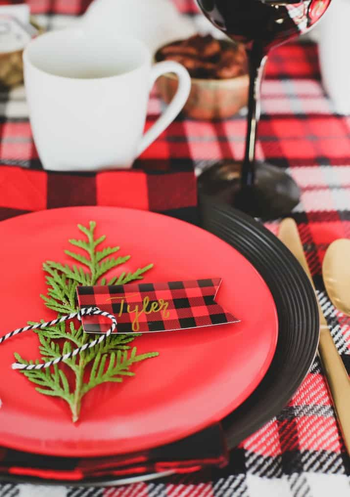 winter brunch plaid tablescape place card tied on to greenery