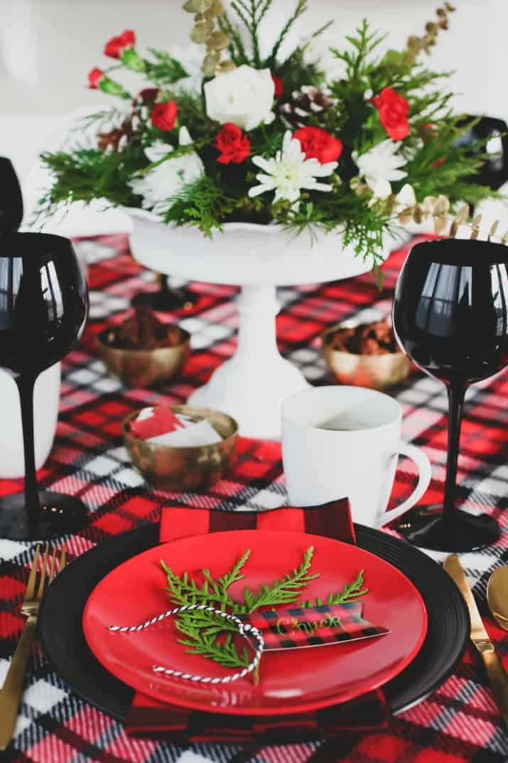 winter brunch plaid tablescape place setting and flowers centerpiece