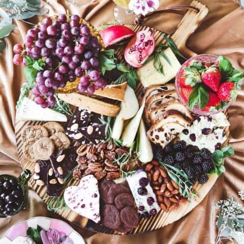 chocolate & cheese dessert board on gold velvet, overhead view