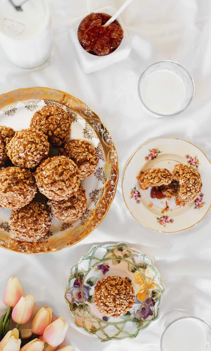 spice muffins with oatmeal topping in brunch setting with china and milk