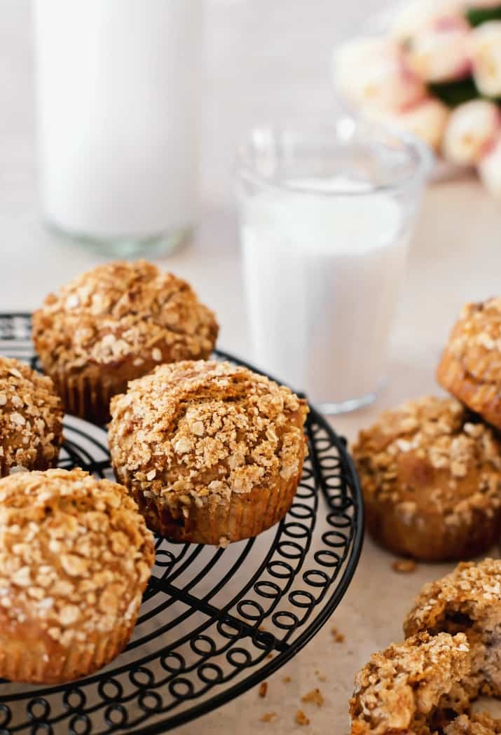spice muffins with oatmeal topping recipe on table with milk