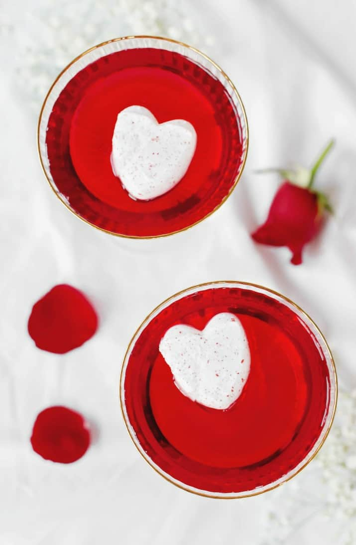 Sweetheart Valentines Day Cocktail with marshmallow hearts floating on top, overhead view