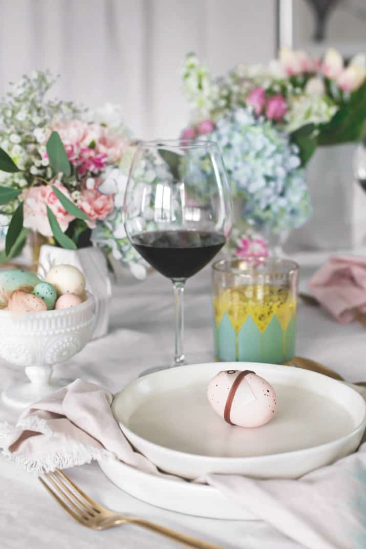 Easter Entertaining Ideas & Menu, tablescape with white plates and wine glass