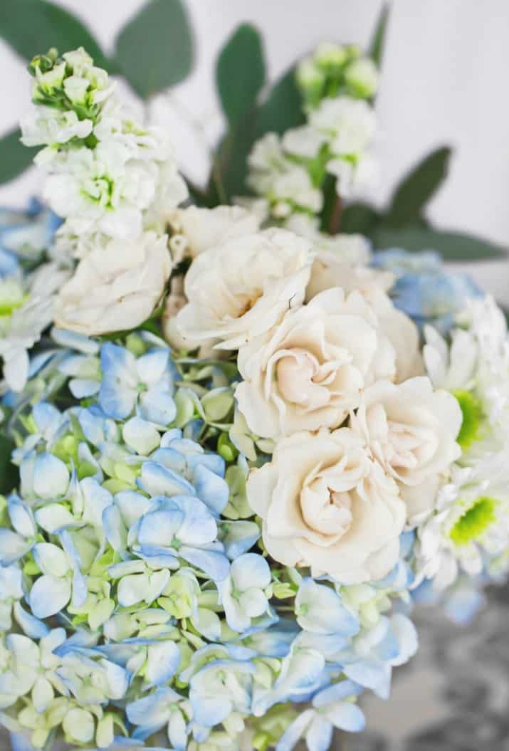 blue and white flowers in arrangement