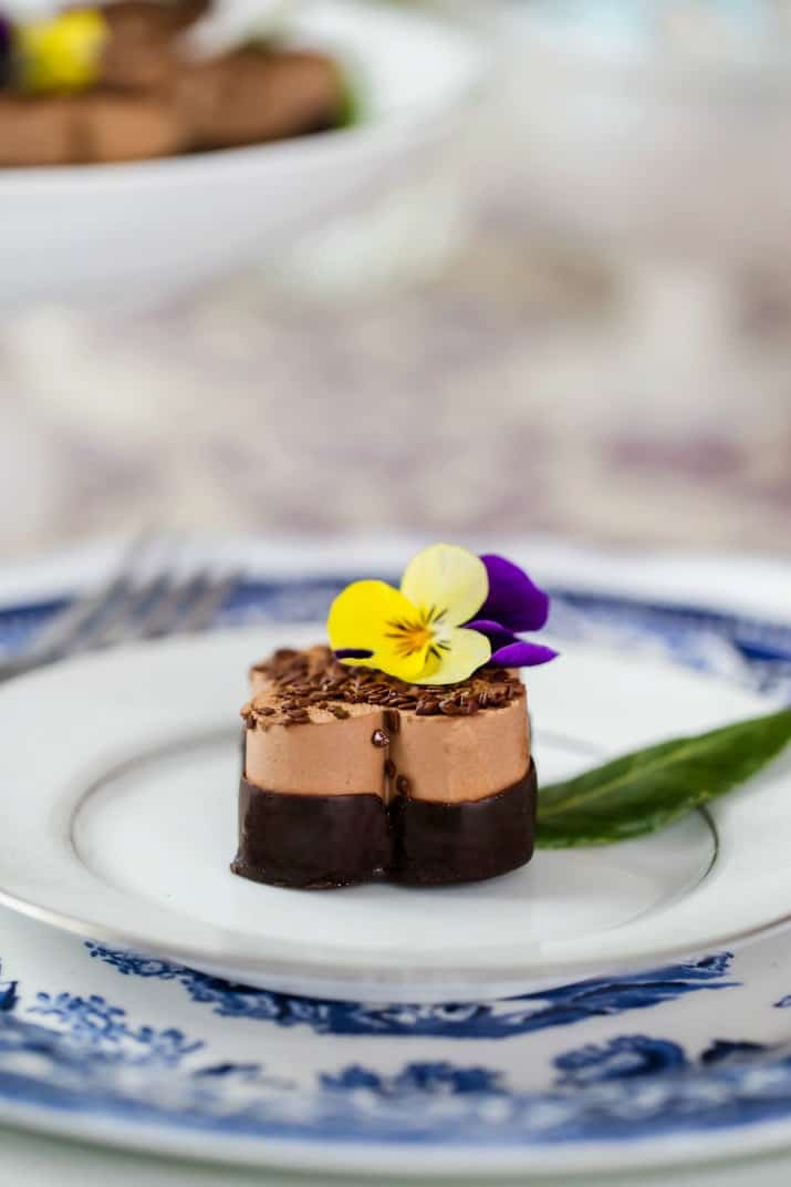mini chocolate mousse on white plate
