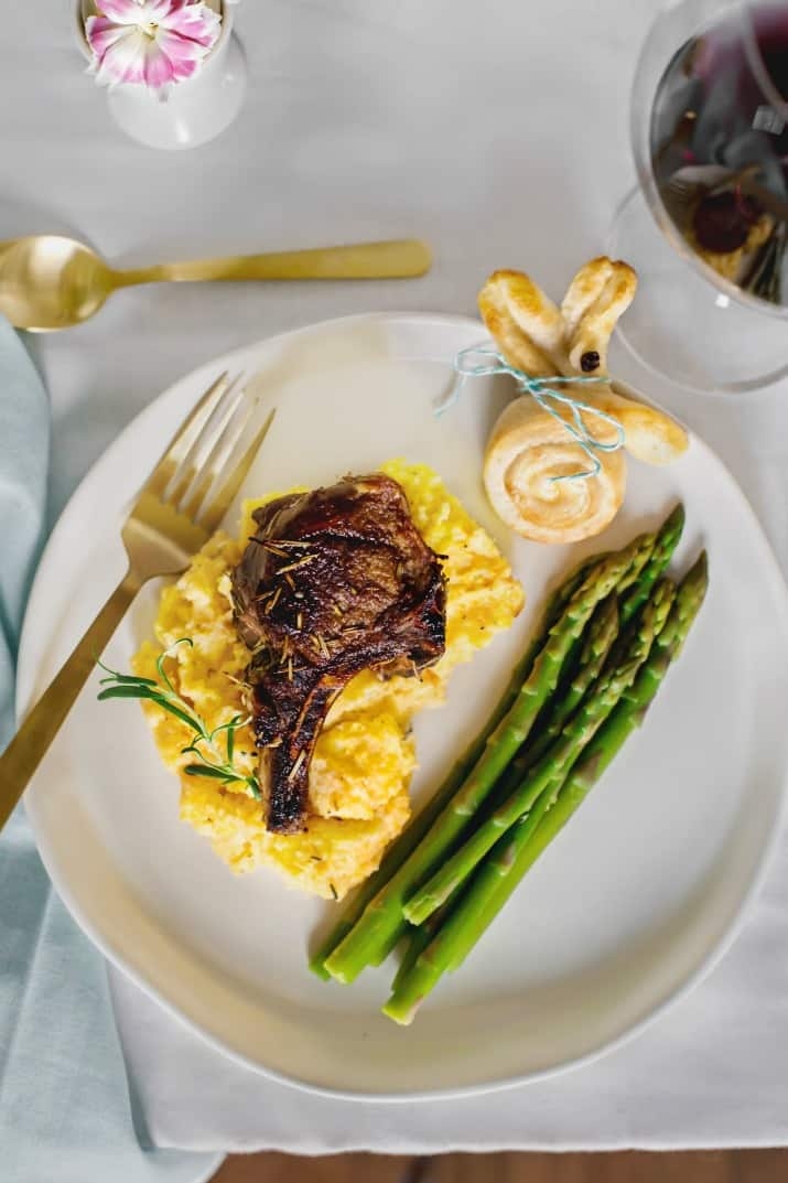 Lamb Chops with Goat Cheese Polenta served on dinner plate with asparagus