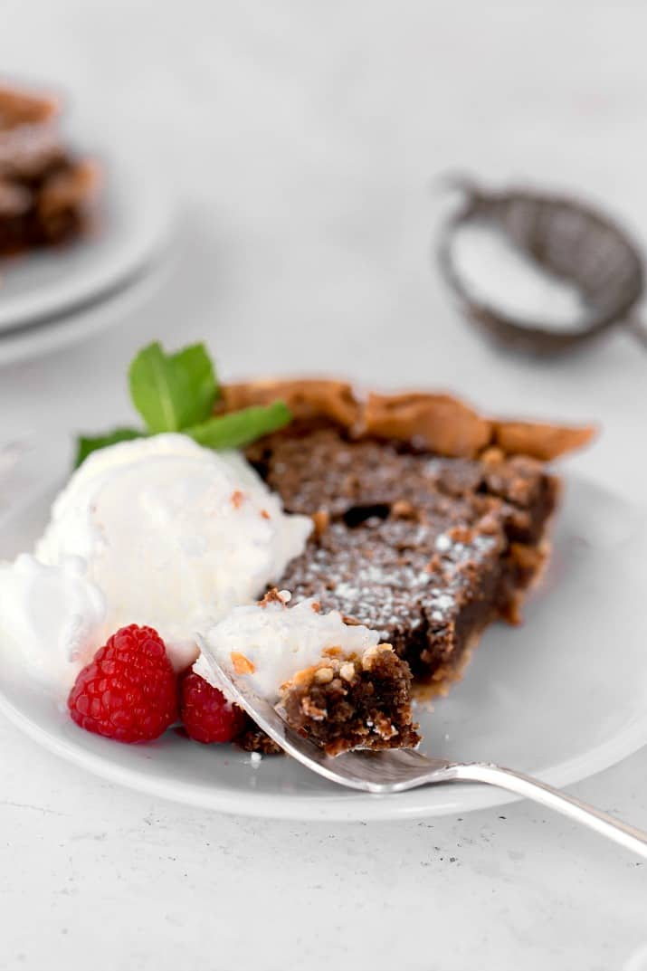 slice of chocolate chess pie and ice cream