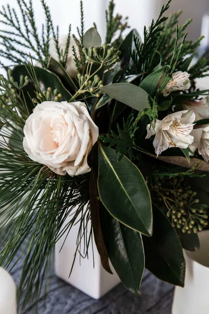 white roses and greenery floral arrangement