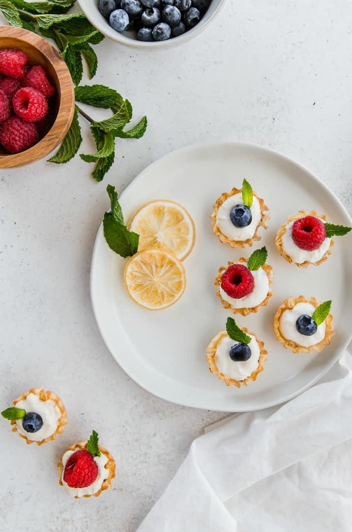 fruit tartlets dessert bites on a white plate