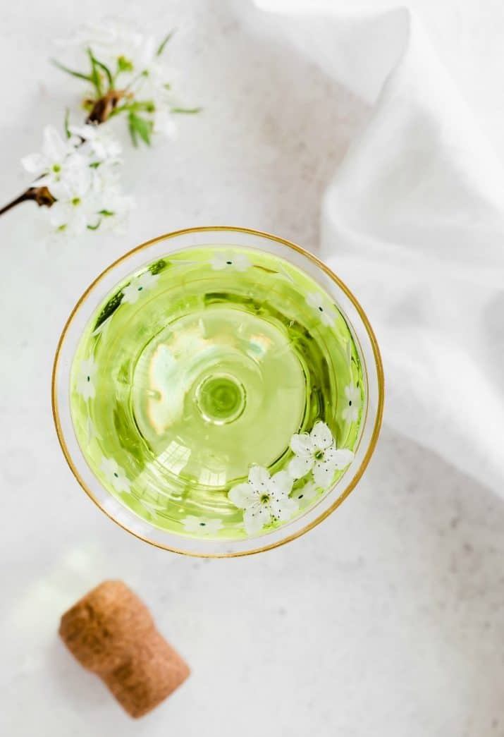 green champagne cocktail in coupe photos