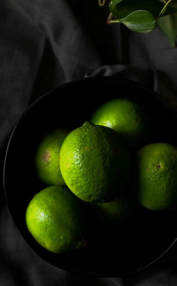 dark and moody limes in bowl