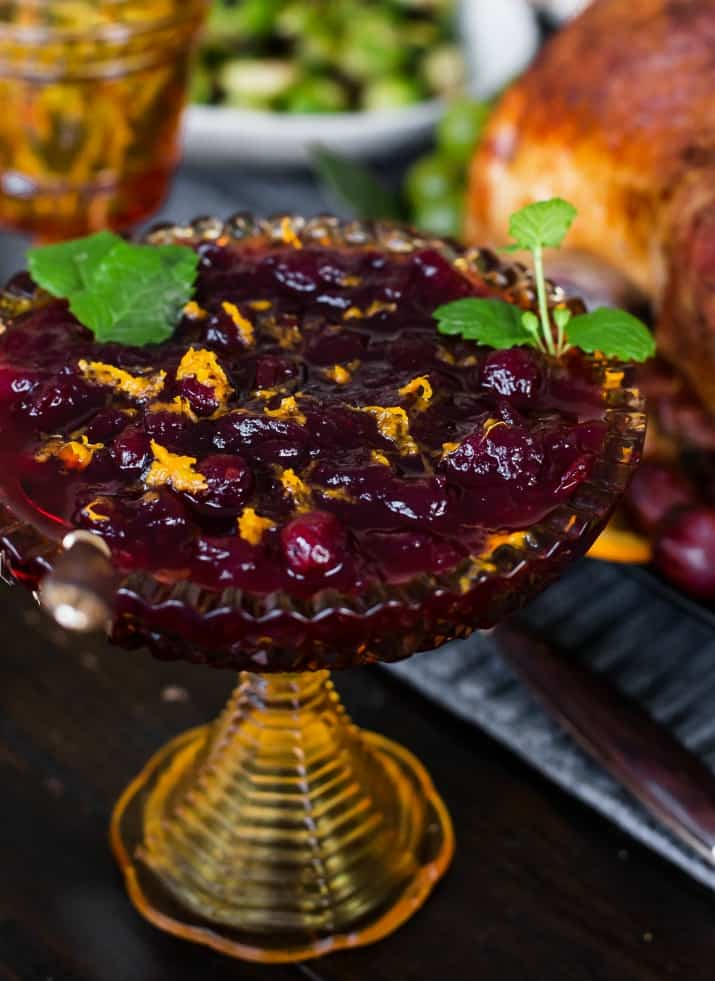 dressed up cranberry sauce with mint garnish
