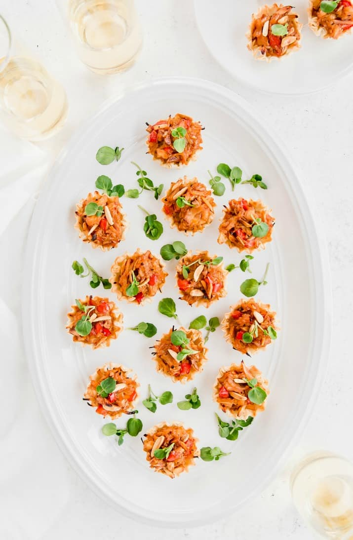 easy chicken appetizers in phyllo shells on white platter, overhead