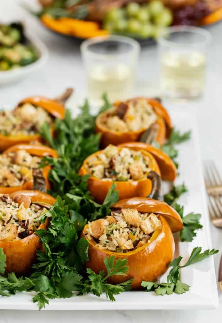 rice dressing mini pumpkins on white platter