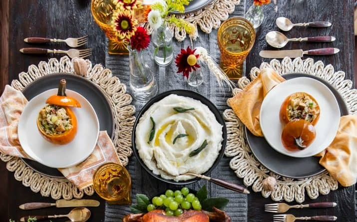 Long Thanksgiving table with food