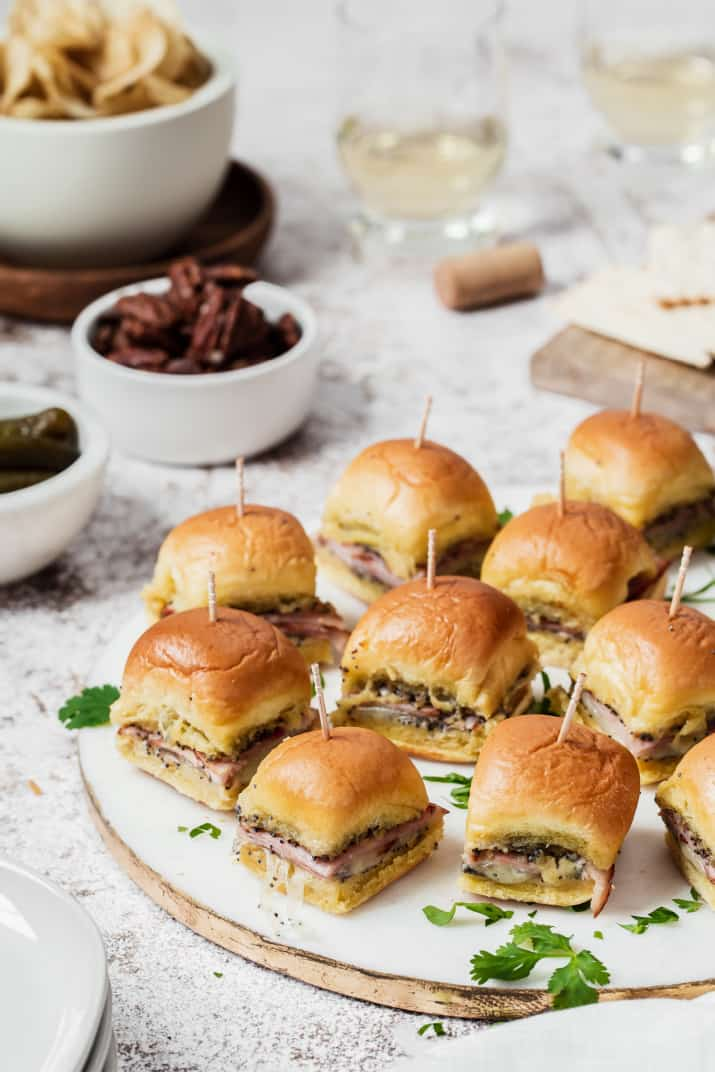 platter of mini sandwiches on party table