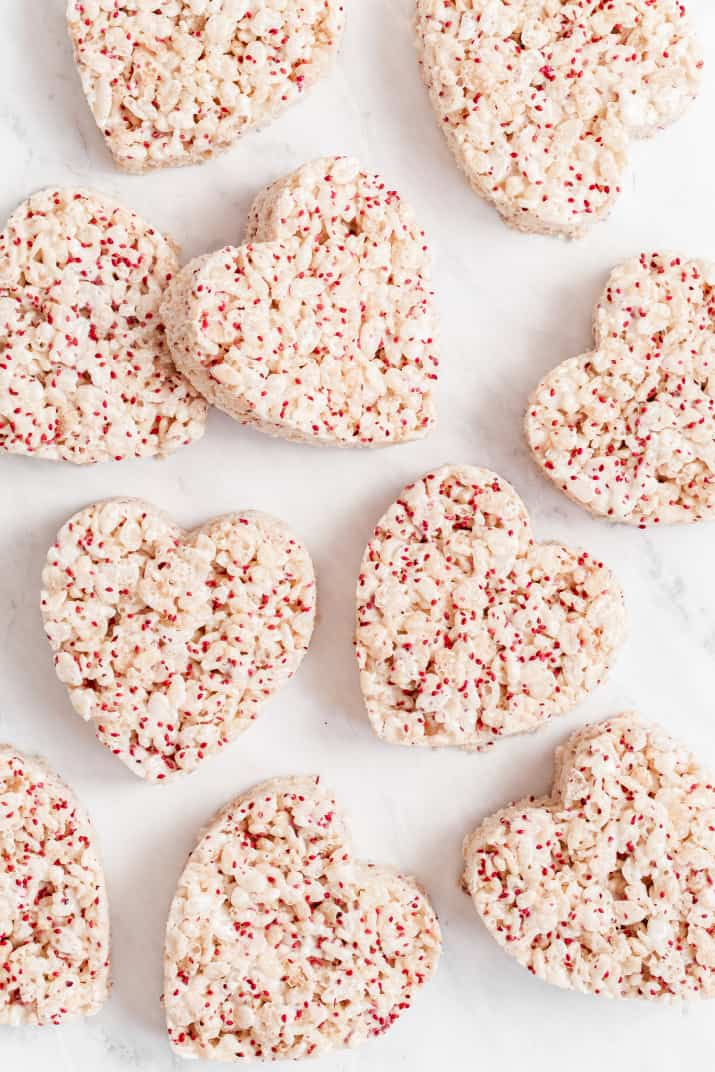 heart shaped rice crispy treats on marble background, overhead
