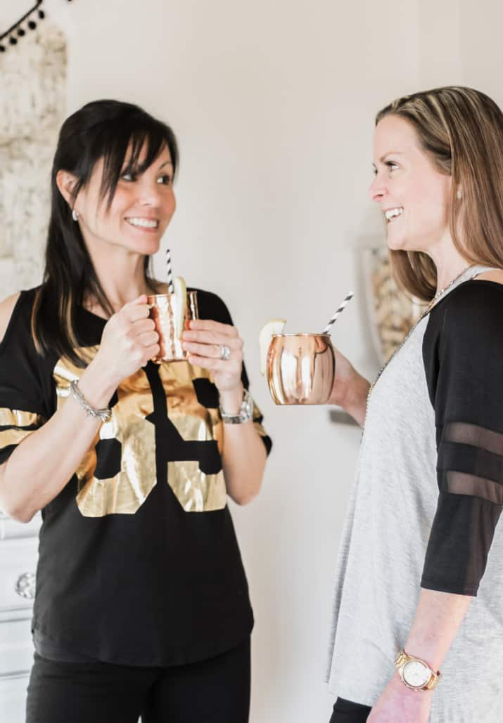 two ladies drinking moscow mules