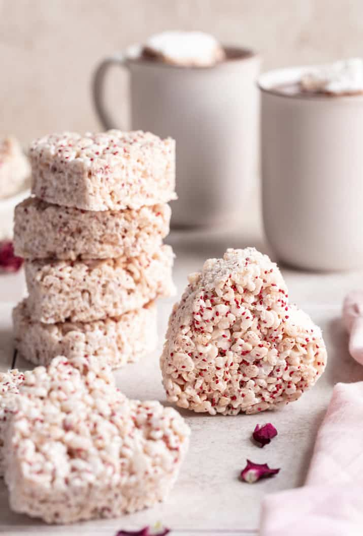 heart shape krispie treat on its side, with hot cocoa mugs