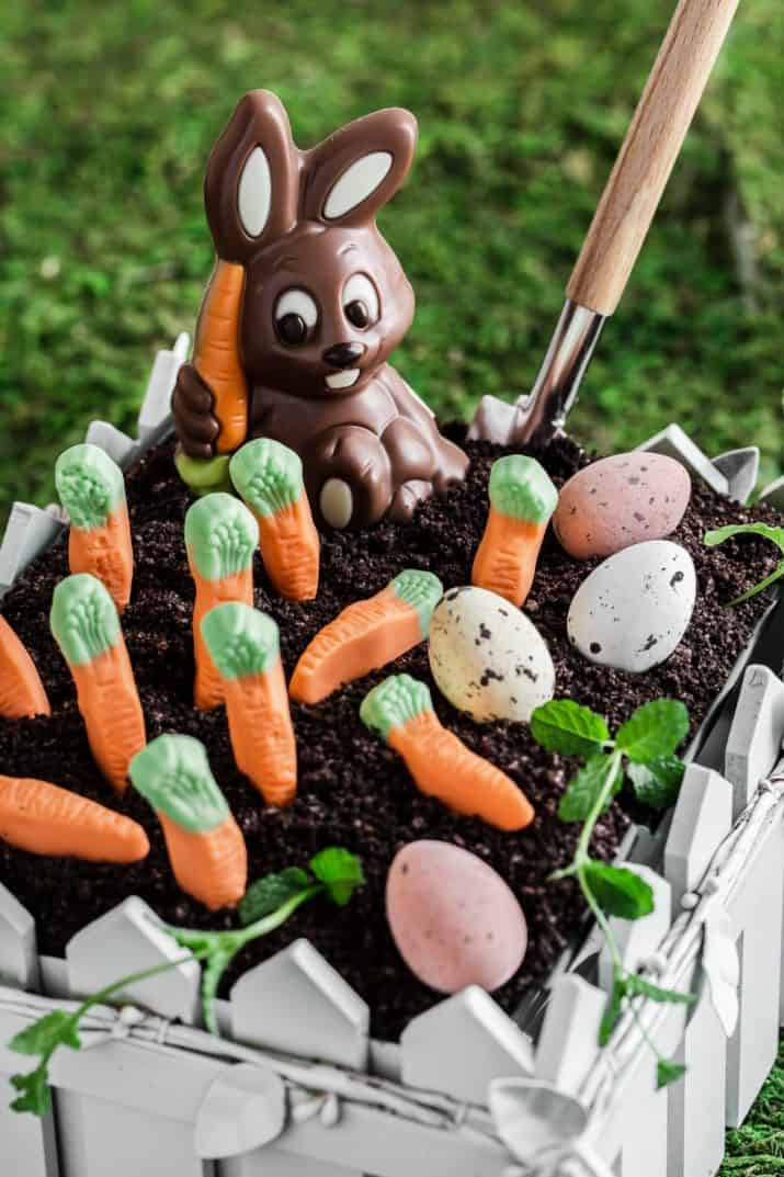 close up of Easter dirt cake with chocolate bunny and candy carrots