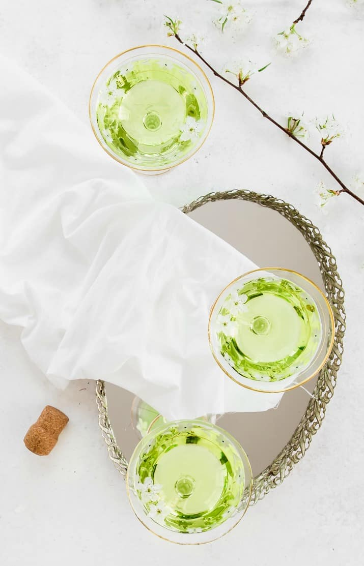 3 green drinks on tray, overhead view