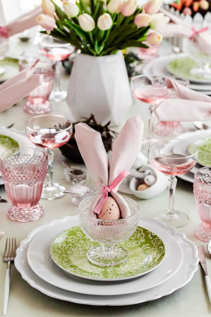 Green plate on white plate with pink napkin bunny ears