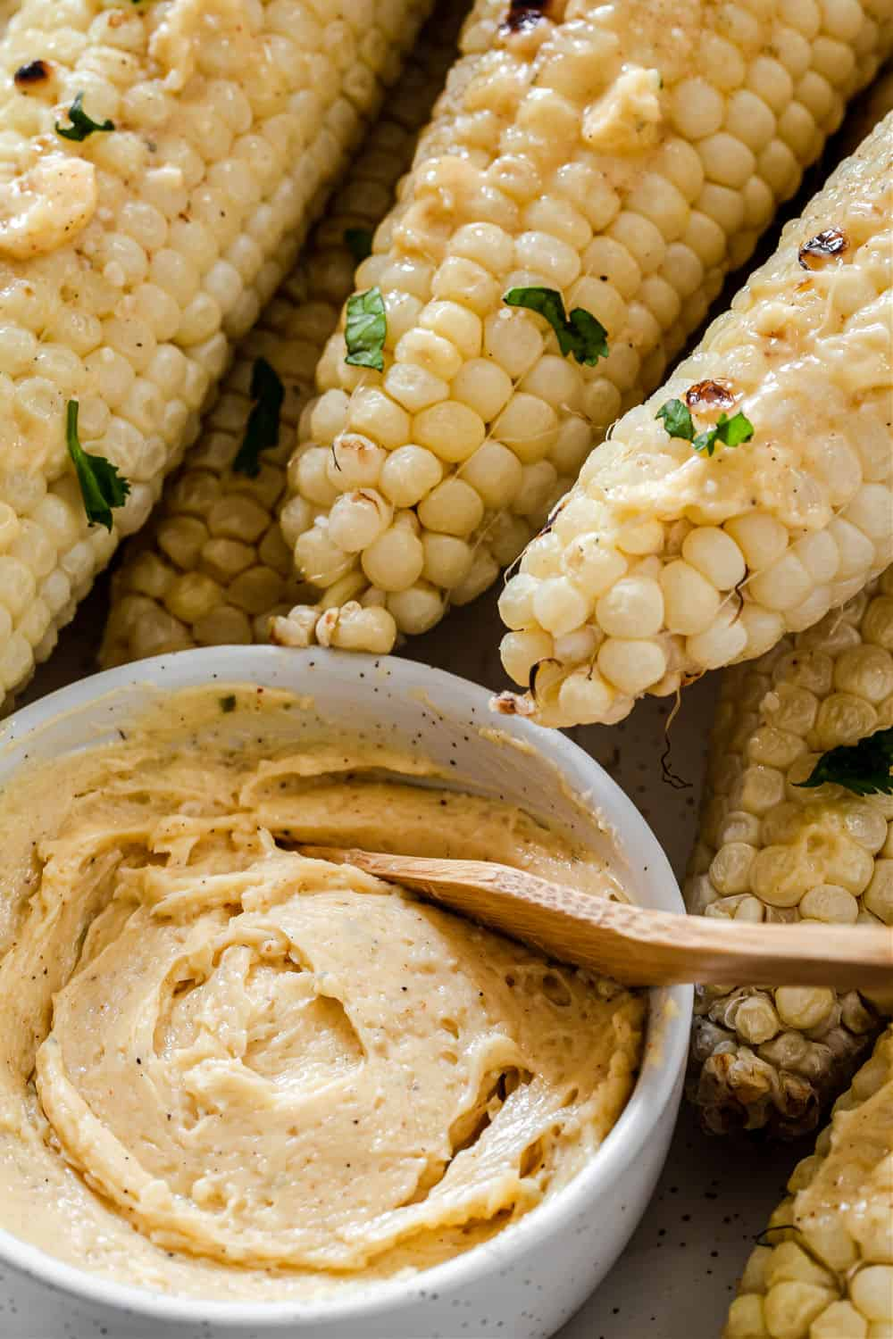 parmesan butter in small bowl with corn