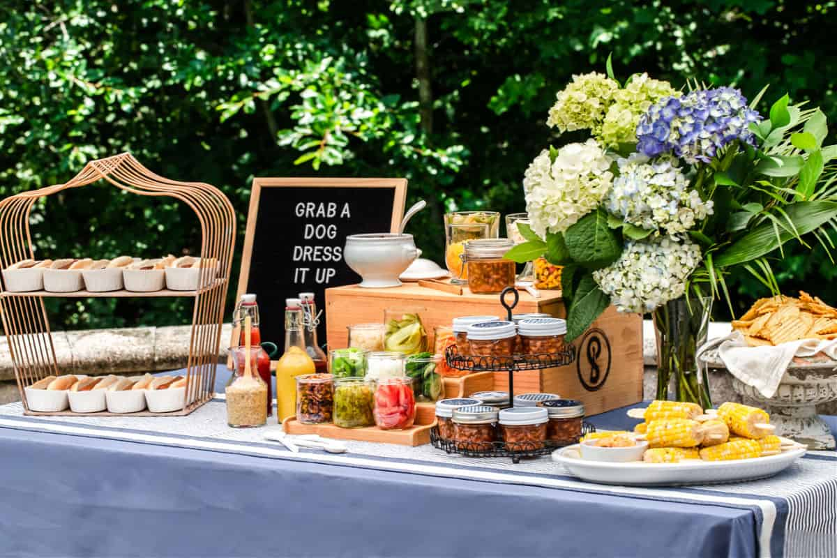 hot dog bar party buffet table with toppings and sides